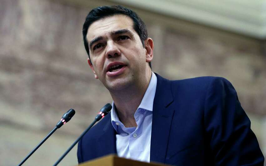 Greece's Prime Minister Alexis Tsipras delivers a speech to his party's lawmakers at the parliament in Athens, on Tuesday, Feb. 17, 2015. Tsipras is facing increasing pressure from international lenders to seek an extension of the country's bailout. During his speech, he announced that his party would endorse former conservative interior minister Prokopis Pavlopoulos as candidate for the country's new president. (AP Photo/Thanassis Stavrakis) ORG XMIT: ATH113