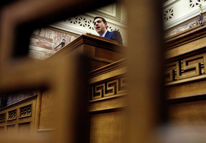 Greece's Prime Minister Alexis Tsipras delivers a speech to his party lawmakers at the parliament in Athens, on Tuesday, Feb. 17, 2015. Tsipras is facing increasing pressure from international lenders to seek an extension of the country's bailout. During his speech, he announced that his party would endorse former conservative interior minister Prokopis Pavlopoulos as candidate for the country's new president. (AP Photo/Thanassis Stavrakis) ORG XMIT: ATH116