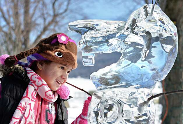 Gabriella Liriano, 4, of Bayshore takes a close look at an ice sculpture, part of the First Annual Lake George Snow Sculpture Contest in Shepard Park Tuesday Feb. 17, 2015 in Lake George, NY.  (John Carl D'Annibale / Times Union) Photo: John Carl D'Annibale / 00030637A