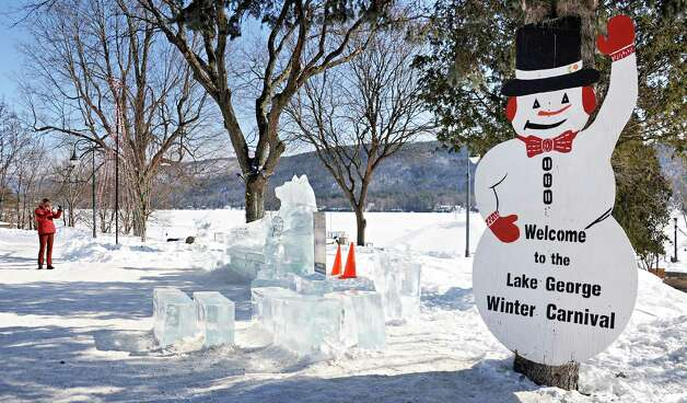 A visitor photographs ice sculptures during the First Annual Lake George Snow Sculpture Contest in Shepard Park Tuesday Feb. 17, 2015 in Lake George, NY.  (John Carl D'Annibale / Times Union) Photo: John Carl D'Annibale / 00030637A