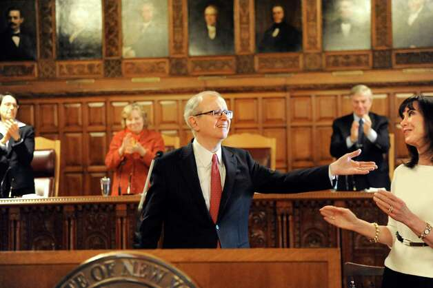 Chief Judge Jonathan Lippman, center, takes in the applause after delivering the State of the Judiciary on Tuesday, Feb. 17, 2015, at the Court of Appeals in Albany, N.Y. (Cindy Schultz / Times Union) Photo: Cindy Schultz / 00030651A