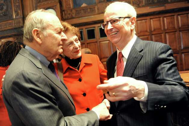 Retired Judge E. Leo Milonas, left, and former Chief Judge Judith Kaye, center, congratulate Chief Judge Jonathan Lippman after he delivers the State of the Judiciary on Tuesday, Feb. 17, 2015, at the Court of Appeals in Albany, N.Y. (Cindy Schultz / Times Union) Photo: Cindy Schultz / 00030651A