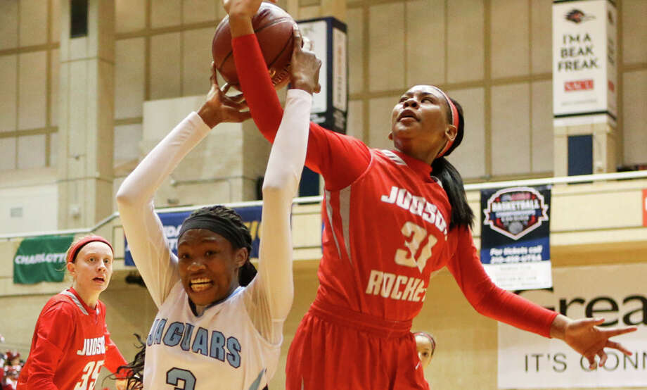 Johnson's Alyssa Adams (3) battles for a rebound with Judson's Desiree Lewis during the first half of their 6A first-round basketball game at the UTSA Convocation Center on Feb. 16, 2015. Photo: Marvin Pfeiffer /San Antonio Express-News / Express-News 2015