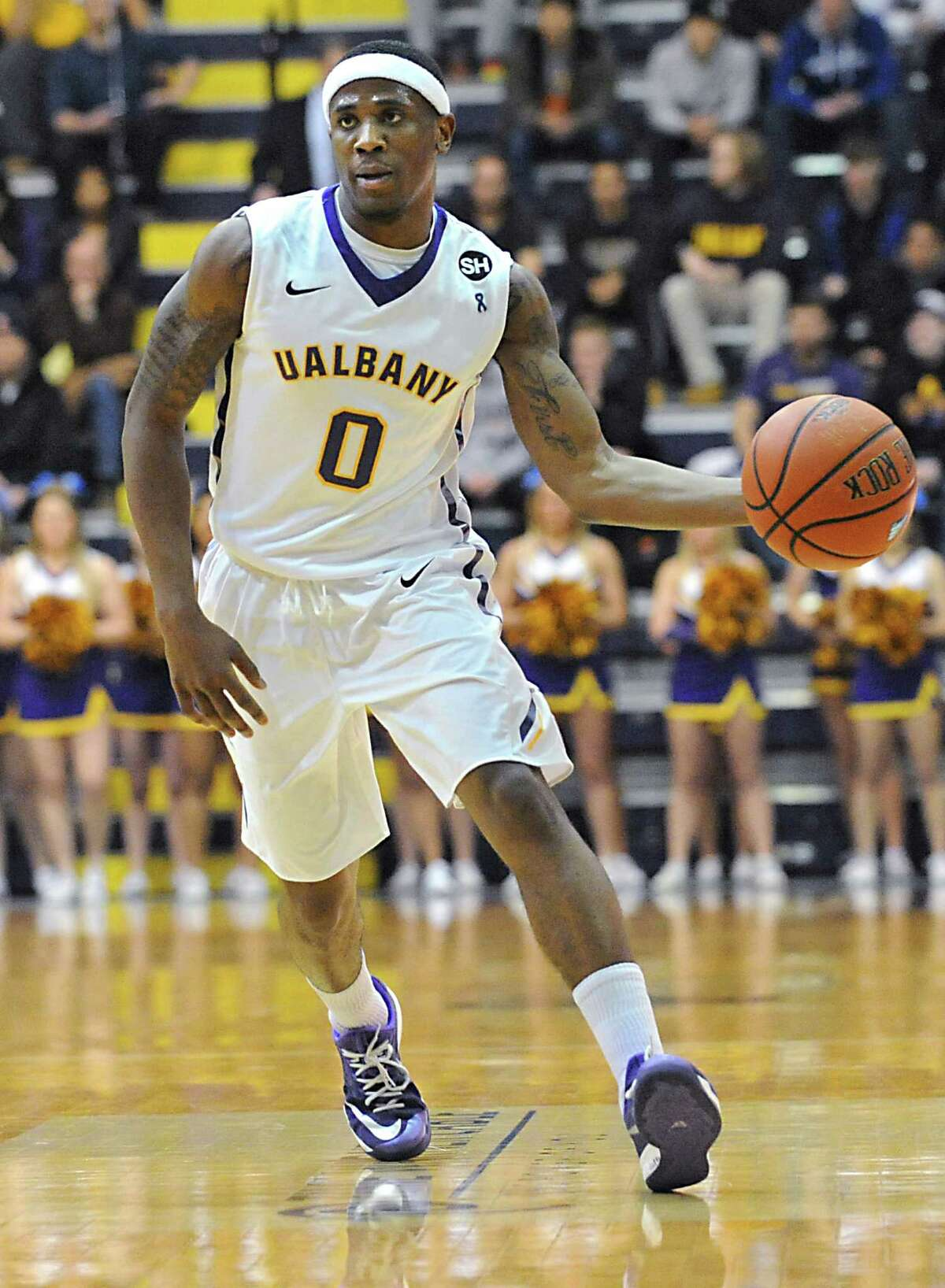 UAlbany's Evan Singletary brings the ball up the court during a basketball game against Stony Brook at the SEFCU arena on Tuesday, Feb. 17, 2015 in Albany, N.Y. (Lori Van Buren / Times Union)