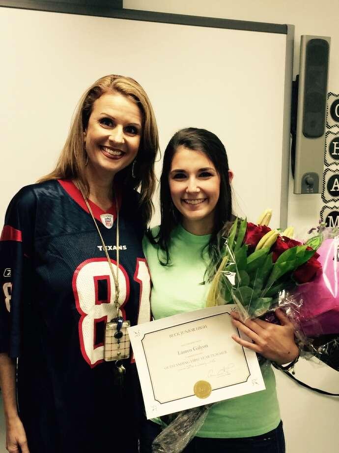 Beck Junior High Principal Carra Fleming congratulates  Beck sixth-grade English teacher Lauren Galyon. Photo: Beck Junior High