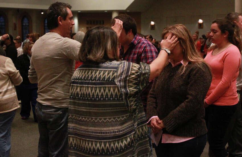Faithful receive ashes on Ash Wednesday February 18, 2015 at Saint Mark the Evangelist Church in San Antonio.