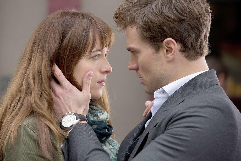 "Dakota Johnson and Jamie Dornan star in ""Fifty Shades of Grey."" Photo: HANDOUT, STR / THE WASHINGTON POST"