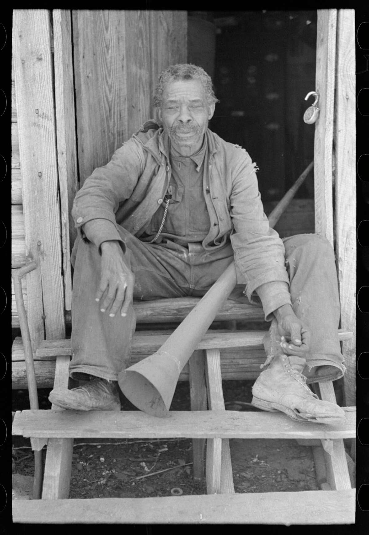 Unidentified former slave with horn with which slaves were called Marshall April 1939