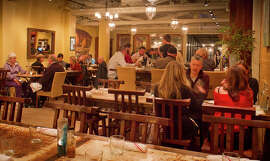 Diners enjoy dinner in the bright, airy dining room at at Mateo's Cocina Latina in Healdsburg.