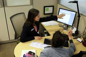 SAN FRANCISCO, CA - APRIL 15:  H & R Block tax preparer Catherine Roman (L) helps Clair Czarecki (R) with her taxes at an H & R Block office on April 15, 2011 in San Francisco, California. Despite having an extra three days to file your income taxes this year, an estimated 15 to 20 million people will wait to the very last minute to file their taxes with a high number relying on tax preparation services.
