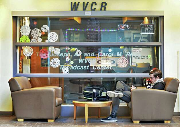 Siena student Andrew Lynch of Watervliet sits outside the 88.3 WVCR-FM DJ booth in the Sarazen Student Union on the Siena campus Thursday Jan. 29, 2015, in Colonie, NY.  (John Carl D'Annibale / Times Union) Photo: John Carl D'Annibale / 00030361A
