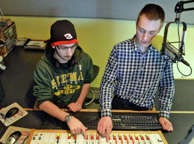 Siena radio DJ's  Joe Gonzales of Hawthorne, NJ, left, and Jimmy Buchanchan of Canojoharie in WVCR's main recording studio in the Sarazen Student Union on the Siena campus Thursday Jan. 29, 2015, in Colonie, NY.  (John Carl D'Annibale / Times Union) Photo: John Carl D'Annibale / 00030361A