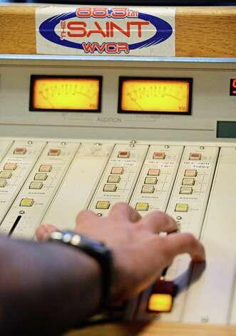 Siena radio DJ Joe Gonzales of Hawthorne, NJ makes sound board adjustments in WVCR's main recording studio in the Sarazen Student Union on the Siena campus Thursday Jan. 29, 2015, in Colonie, NY.  (John Carl D'Annibale / Times Union) Photo: John Carl D'Annibale / 00030361A