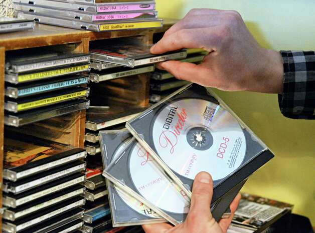 Siena radio DJ Jimmy Buchanchan of Canojoharie sorts CD's in WVCR's main recording studio in the Sarazen Student Union on the Siena campus Thursday Jan. 29, 2015, in Colonie, NY.  (John Carl D'Annibale / Times Union) Photo: John Carl D'Annibale / 00030361A