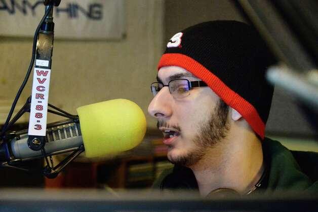 Siena radio DJ Joe Gonzales of Hawthorne, NJ in WVCR's main recording studio in the Sarazen Student Union on the Siena campus Thursday Jan. 29, 2015, in Colonie, NY.  (John Carl D'Annibale / Times Union) Photo: John Carl D'Annibale / 00030361A