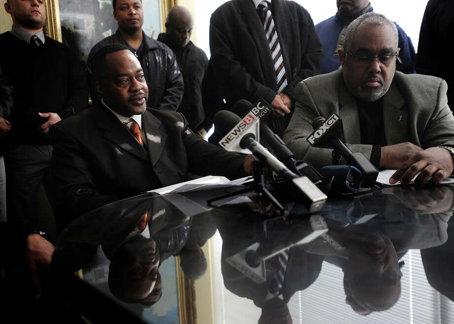 Detective Harold Dimbo, left, vice president of the Bridgeport Guardians, and Hubert Smith, vice president of the National Association of Black Law Enforcement Officers, Inc., address the topic of racist letters being circulated around the Bridgeport Police Department, at the law offices of Willinger, Willinger & Bucci in Bridgeport, Conn. on Wednesday, February 18, 2015. The state police are conducting the investigation into the matter. Photo: Brian A. Pounds / Connecticut Post