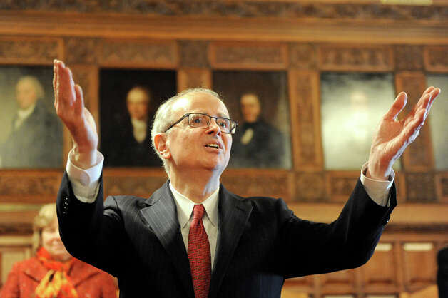 Chief Judge Jonathan Lippman, center, takes in the applause after delivering the State of the Judiciary on Tuesday, Feb. 17, 2015, at the Court of Appeals in Albany, N.Y. (Cindy Schultz / Times Union) Photo: Cindy Schultz, Albany Times Union / 00030651A