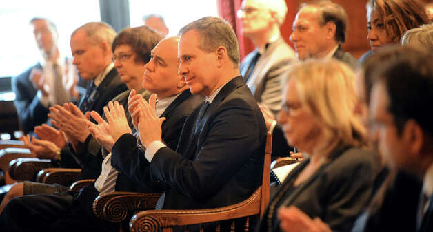 New York Attorney General Eric Schneiderman, center, and, to his left, Comptroller Thomas DiNapoli applaud during the State of the Judiciary address on Tuesday, Feb. 17, 2015, at the Court of Appeals in Albany, N.Y. (Cindy Schultz / Times Union) Photo: Cindy Schultz, Albany Times Union / 00030651A