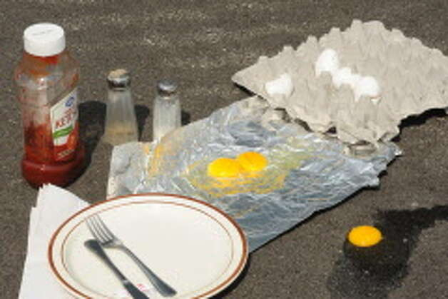 An experiment to see if it was hot enough for an egg to cook on the tarmac at Albany International Airport on Tuesday July 16, 2013 in Colonie, N.Y.  (Michael P. Farrell/Times Union archive) Photo: Michael P. Farrell / 00023189A