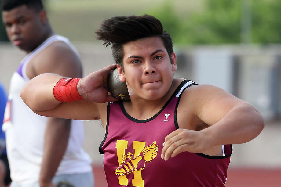 Harlandale's Andres Garcia wiinds up for a throw in the 4A shot put during the UIL state track meet at Myers Stadium in Austin on May 9, 2014. Photo: Marvin Pfeiffer / San Antonio Express-News / Express-News 2014