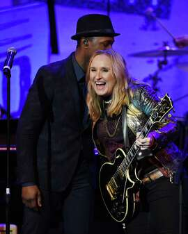 Melissa Etheridge, shown hugging Aloe Blacc at the 17th annual Grammy Foundation Legacy Concert on Feb. 5, will perform during the second intermission of Saturday's outdoor hockey game at Levi's Stadium.