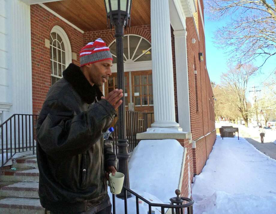 Anthony Pugh leaves Milford Superior Court after testifying in the murder trail of his cousin, Matthew Pugh on Wednesday, Feb. 18, 2015. Photo: Michael P. Mayko / Connecticut Post