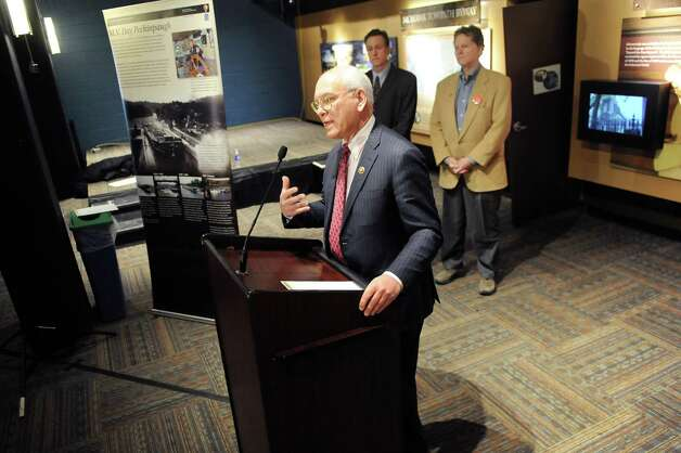 Rep. Paul Tonko, center, speaks during a news conference to announce Erie Canalway grants on Wednesday, Feb. 18, 2015, at Proctors Theatre in Schenectady, N.Y. (Cindy Schultz / Times Union) Photo: Cindy Schultz / 00030544A