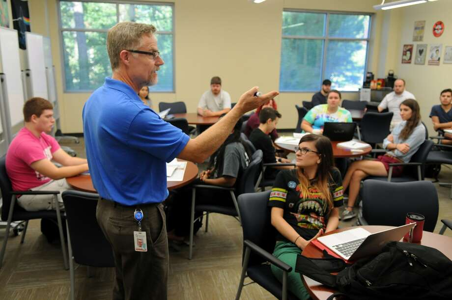 David Kennedy, left, director of the Honors College and Political Science professor  at Lone Star College - Montgomery, talked to Claire Goodwin, right, of The Woodlands, during a class in the fall. Photo: Jerry Baker, Freelance