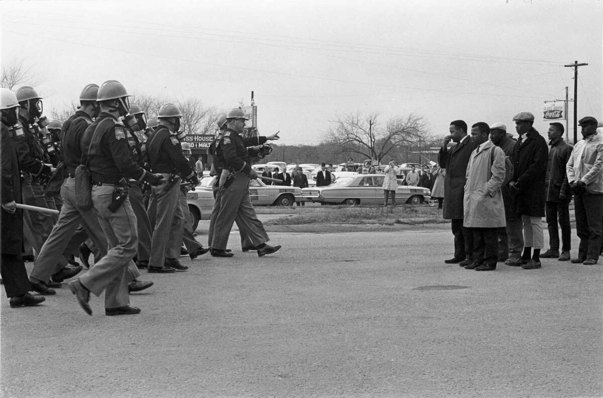 """Hundreds of previously unseen photos of the 1965 civil rights marches from Selma, Ala., to Birmingham captured by James """"Spider"""" Martin, an Alabama photojournalist, have been acquired by the Briscoe Center for American History at the University of Texas at Austin. The archive - purchased by the university from Martin's estate for $250,000, according to the New York Times - includes more than 1,000 photo negatives tied to the marches as photos and documents from the trial of Ku Klux Klan member Collie Leroy Wilkins - tried for the 1965 shooting murder of Viola Liuzzo, a civil rights activist from Michigan who was transporting marchers from Montgomery back to Selma - and Alabama Governor George Wallace's 1968 presidential campaign."""