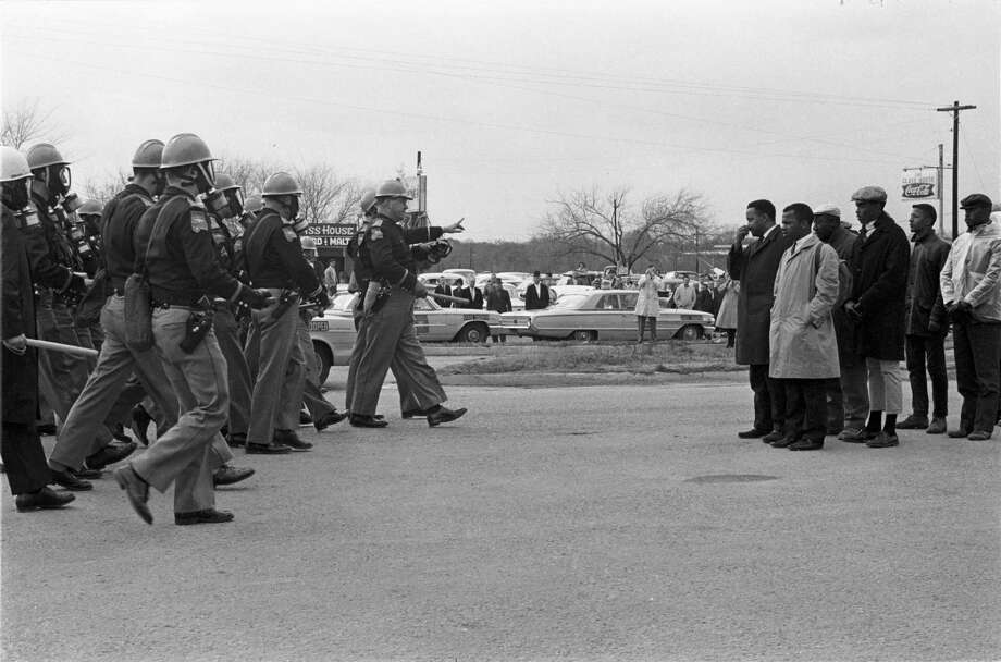 "Hundreds of previously unseen photos of the 1965 civil rights marches from Selma, Ala., to Birmingham captured by James ""Spider"" Martin, an Alabama photojournalist, have been acquired by the Briscoe Center for American History at the University of Texas at Austin. The archive — purchased by the university from Martin's estate for $250,000, according to the New York Times — includes more than 1,000 photo negatives tied to the marches as photos and documents from the trial of Ku Klux Klan member Collie Leroy Wilkins — tried for the 1965 shooting murder of Viola Liuzzo, a civil rights activist from Michigan who was transporting marchers from Montgomery back to Selma — and Alabama Governor George Wallace's 1968 presidential campaign. Photo: Photo: James ""Spider"" Martin, Courtesy Of Briscoe Center For American History"