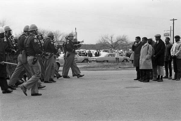 """Hundreds of previously unseen photos of the 1965 civil rights marches from Selma, Ala., to Birmingham captured by James """"Spider"""" Martin, an Alabama photojournalist, have been acquired by the Briscoe Center for American History at the University of Texas at Austin. The archive — purchased by the university from Martin's estate for $250,000, according to the New York Times — includes more than 1,000 photo negatives tied to the marches as photos and documents from the trial of Ku Klux Klan member Collie Leroy Wilkins — tried for the 1965 shooting murder of Viola Liuzzo, a civil rights activist from Michigan who was transporting marchers from Montgomery back to Selma — and Alabama Governor George Wallace's 1968 presidential campaign."""