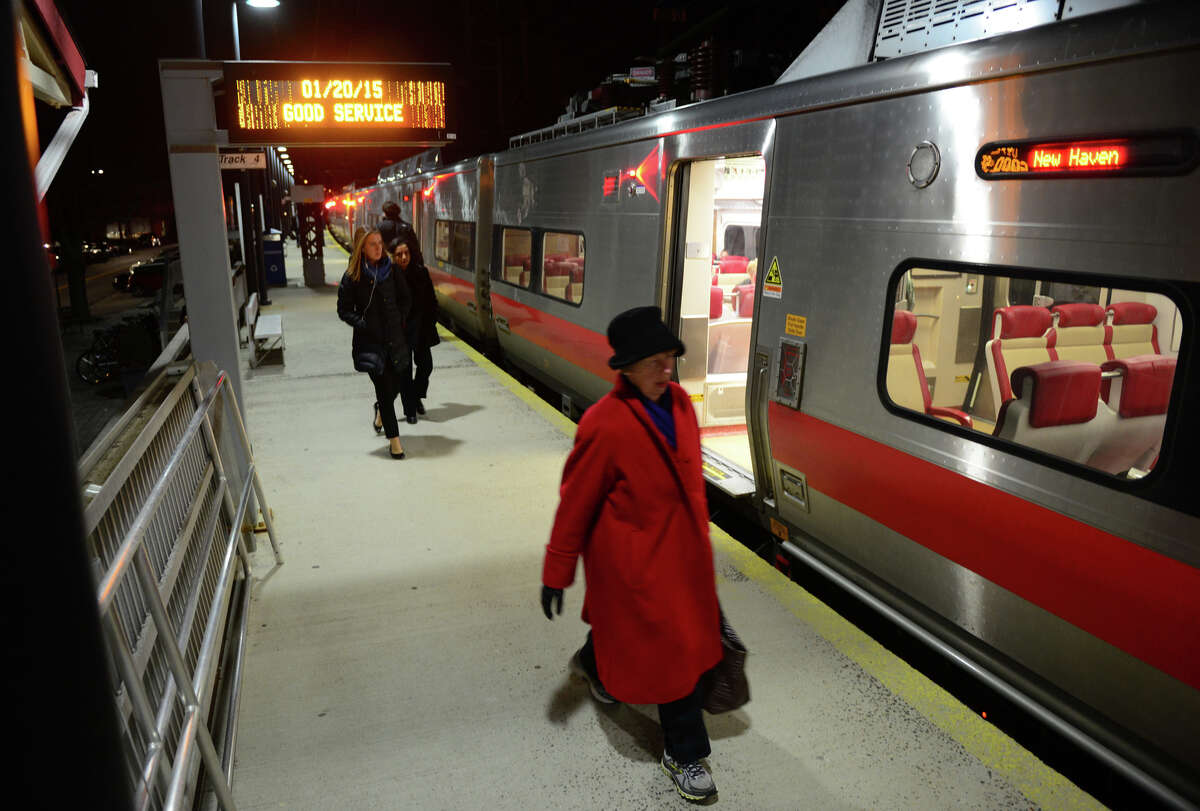 Commuters arrive at the downtown Metro-North station on Carter Henry Drive in Fairfield, Conn. on Tuesday Jan. 20, 2015. A massive long-term investment in Connecticut's transportation infrastructure is the centerpiece of Gov. Dannel P. Malloy's budget