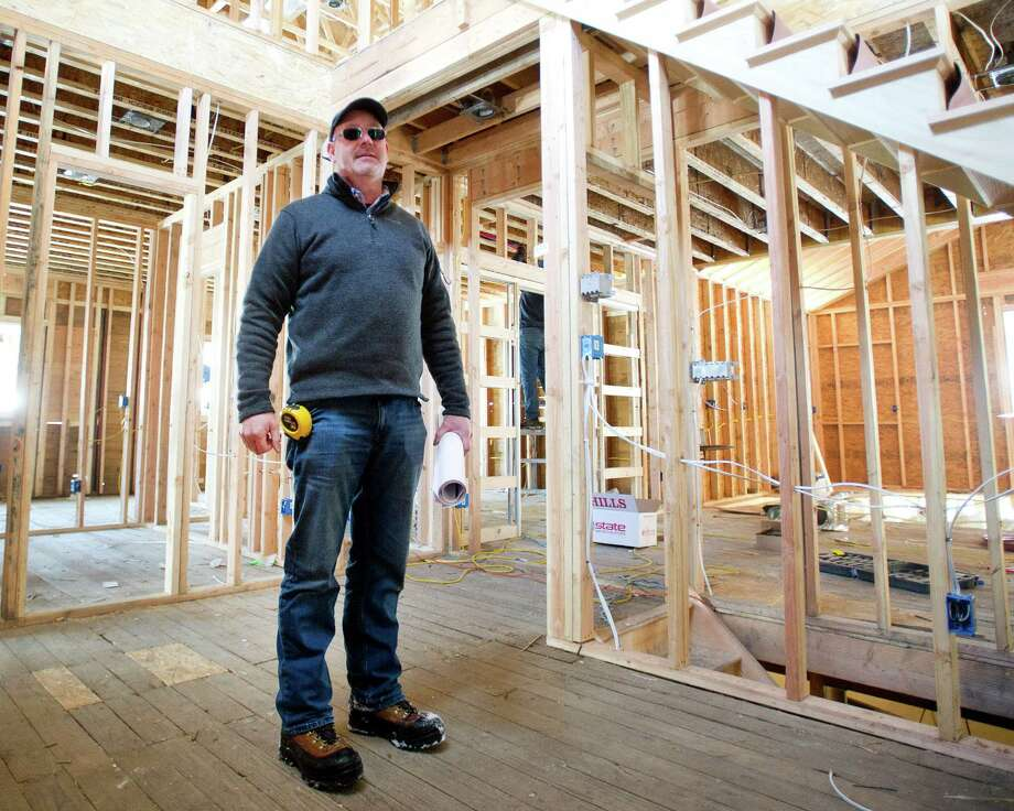 Tony O'Neill of BI-TON Builders stands inside a house under construction at 369 Hoyt Street on the Stamford-Darien border on Tuesday, February 17, 2015. Photo: Lindsay Perry / Stamford Advocate