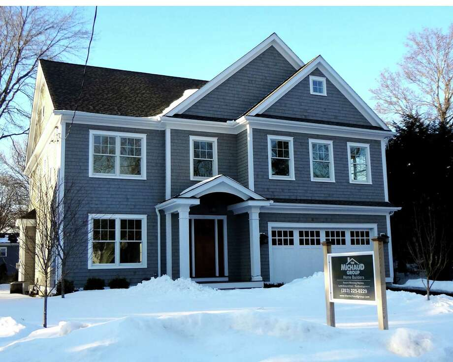 Builders say the single family home construction market has been slower to recover in towns east of Westport, Conn., but expect activity to pick up. Pictured is a recently completed home on the market near Fairfield University, on Feb. 18, 2015. Photo: Alexander Soule / Stamford Advocate