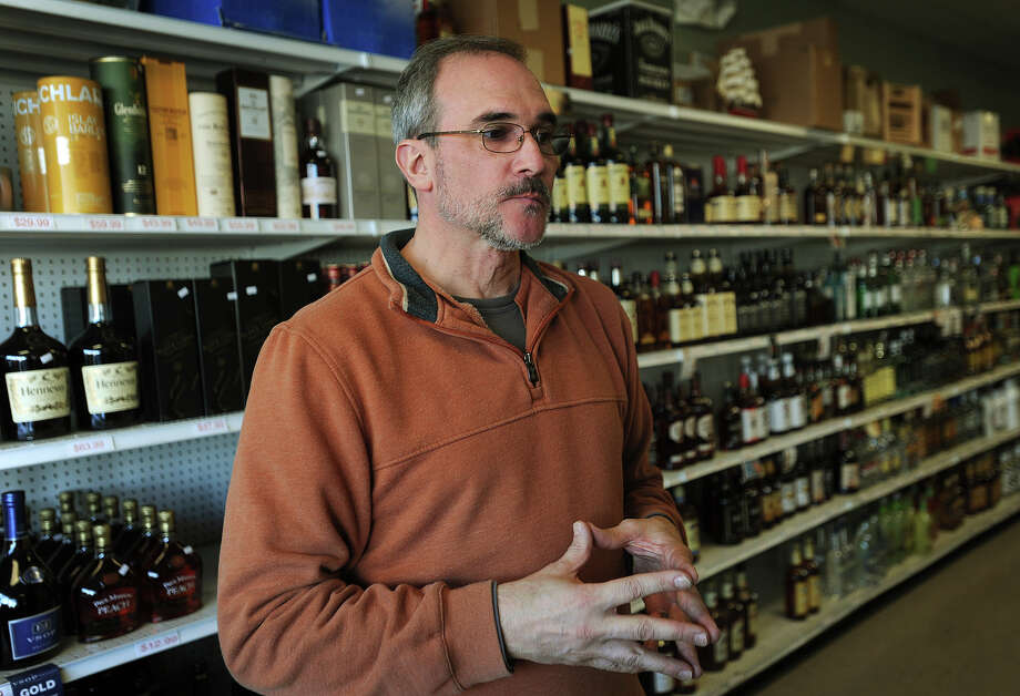 Frank Perillo, owner of Lordship Wine and Liquor in Stratford, thinks the governor's plan to get rid of state minimum pricing will put mom and pop liquor stores like his out of business. Photo: Brian A. Pounds / Connecticut Post