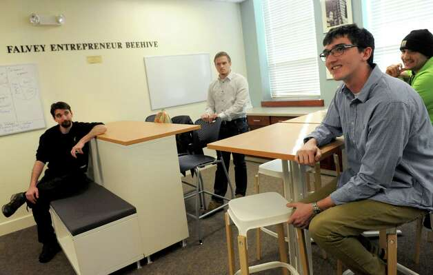 Siena College's Stack Center for Innovation and Entrepreneurship students, left to right, Donald Seebald, Simon Bruno, James Costello and Chris Shoemaker talk about their entrepreneurial ideas at the college on Wednesday Feb. 11, 2015 in Loudonville ,N.Y.  (Michael P. Farrell/Times Union) Photo: Michael P. Farrell / 00030572A