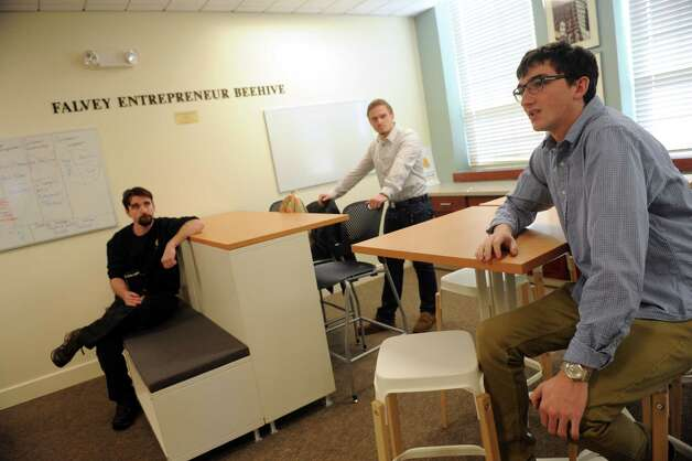 Siena College's Stack Center for Innovation and Entrepreneurship students, left to right, Donald Seebald, Simon Bruno and  James Costello talk about their entrepreneurial ideas at the college on Wednesday Feb. 11, 2015 in Loudonville ,N.Y.  (Michael P. Farrell/Times Union) Photo: Michael P. Farrell / 00030572A