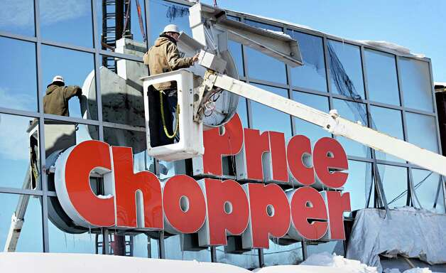 Jordan Bellinger of Signworks sign corp. of Queensbury takes down the old Price Chopper sign at the Shopper's World plaza on Rt. 146 Wednesday, Feb. 18, 2015, in Clifton Park, N.Y. According Price Chopper spokesperson Mona Golub, the sign was removed to make way for Market 32?s new contemporary facade. (John Carl D'Annibale / Times Union) Photo: John Carl D'Annibale / 00030678A