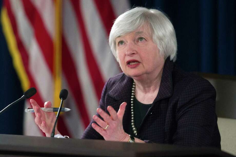 FILE - In this Dec. 17, 2014 file photo, Federal Reserve Chair Janet Yellen speaks with reporters at the Federal Reserve in Washington. The Federal Reserve releases minutes from its Jan 27-28 meeting on Wednesday, Feb. 18, 2015. (AP Photo/Cliff Owen, File) Photo: Cliff Owen, FRE / FR170079 AP