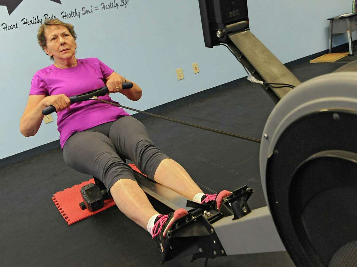 Margaret French of Saratoga Springs uses the rowing machine at Full Circle Fitness on Thursday, Feb. 12, 2015 in Albany, N.Y. The 71-yr-old is training for the 2015 C.R.A.S.H.-B. Sprints which will be held on Sunday, March 1st at Boston University's Agganis Arena. (Lori Van Buren / Times Union)