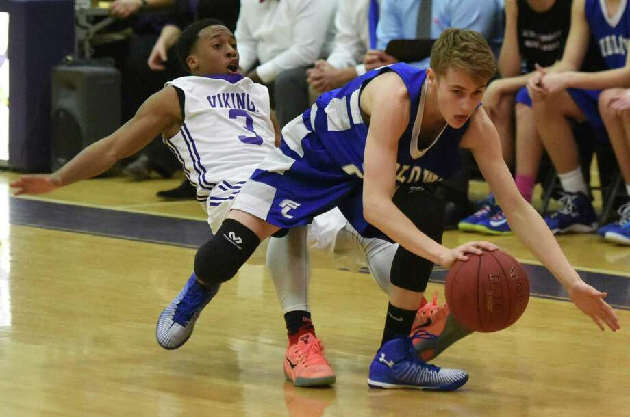 Westhill's C.J. Donaldson, left, gets knocked over by Fairfield Ludlowe's Cole Prowitt Smith in Westhill's 61-38 win over Fairfield Ludlowe in the high school boys basketball game at Westhill High School in Stamford, Conn. Wednesday, Feb. 18, 2015. Photo: Tyler Sizemore / Greenwich Time