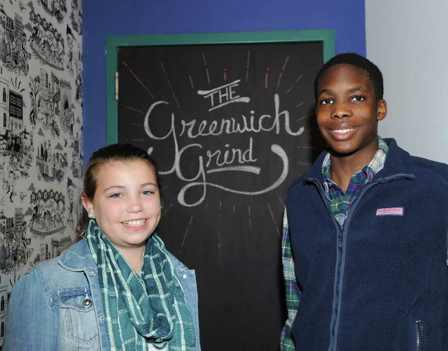 Elyse Crimmins, 12, left, and Caleb Osemobor, 15, both of Greenwich, at the Greenwich Teen Center's new coffee house, the Greenwich Grind, located on the upper floor of the center, that opened for business on Wednesday, Feb. 18, 2015. A naming contest was held for the coffee house with three Greenwich students including, Crimmins, Osemobor and Trinity Holmberg, submitting the same winning name, The Greenwich Grind. Photo: Bob Luckey / Greenwich Time
