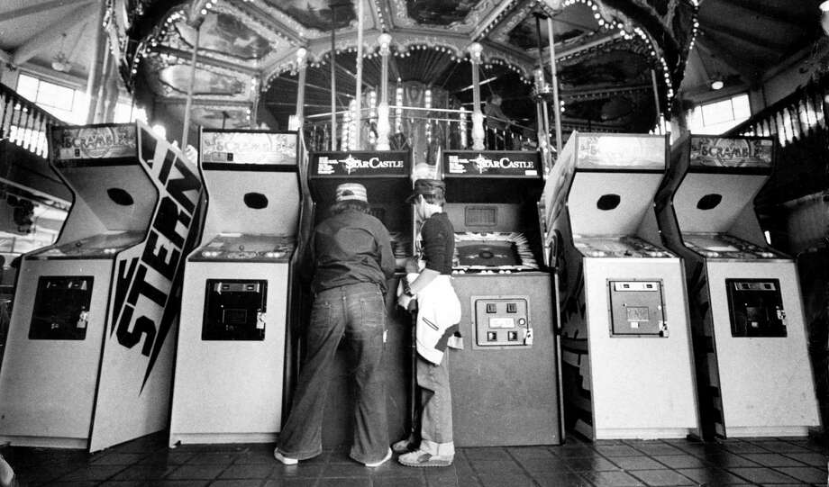 Kids play at the arcade at Pier 39 on Aug. 3, 1982. Photo: Eric Luse / The Chronicle / ONLINE_YES