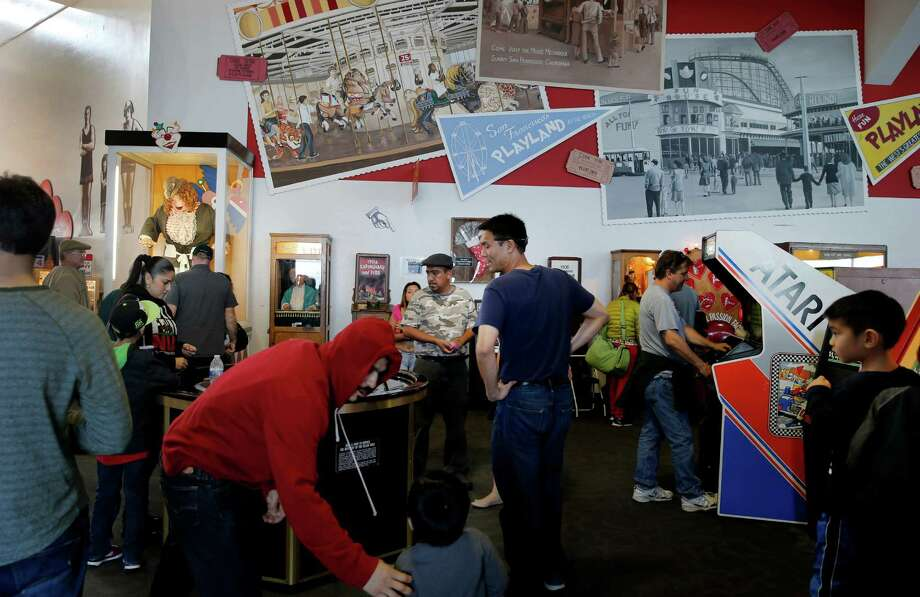 Arcade visitors linger near the entrance of today's Musee Mecanique, now located at Fisherman's Wharf. Photo: Brant Ward / The Chronicle / ONLINE_YES