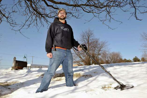 Steven Bell of Saratoga Springs poses with his metal detector on Wednesday, Feb. 18, 2015, in Clifton Park, N.Y.  Bell recently found a diamond wedding and engagement ring that a woman threw out into the snow after an argument with her husband.      (Paul Buckowski / Times Union) Photo: PAUL BUCKOWSKI / 00030677A
