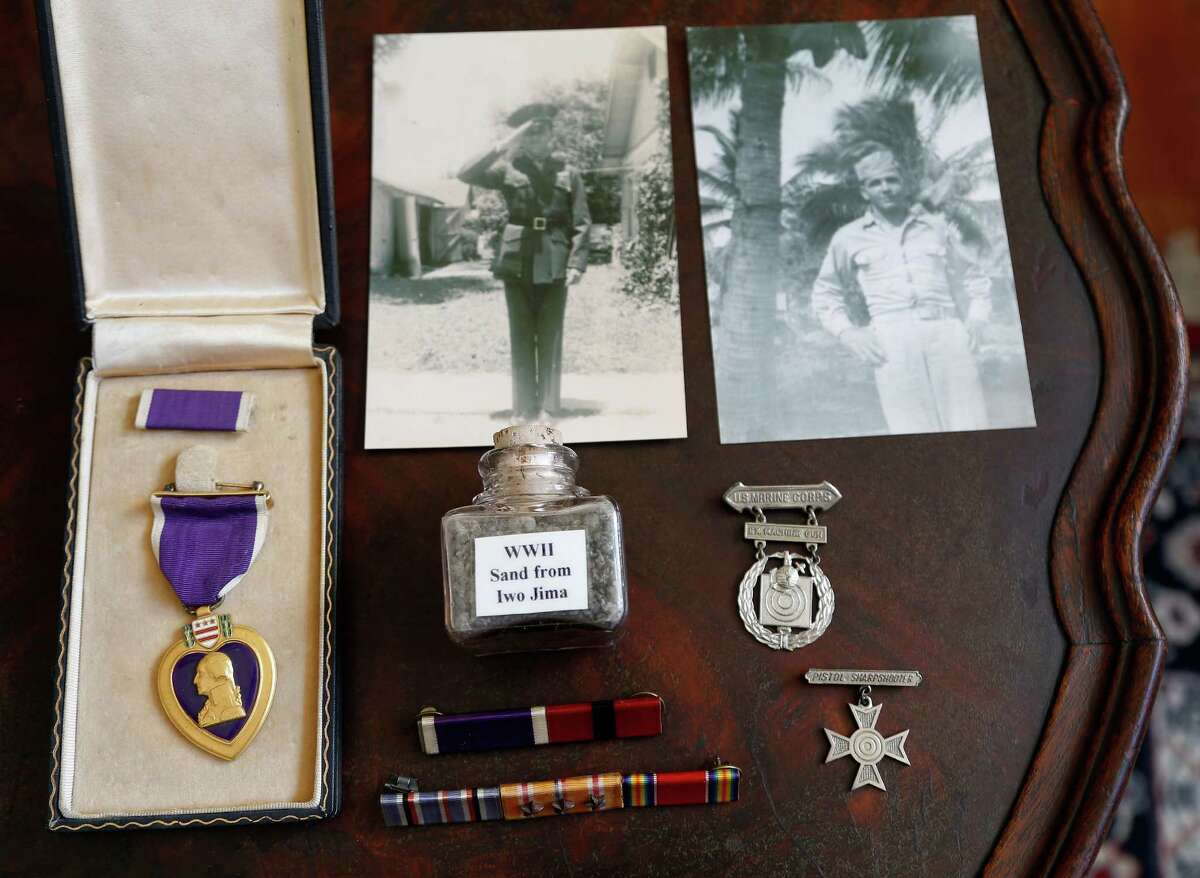 A Purple Heart and other items collected by Bill Sherrill, whose combat career was cut short by a Japanese rifleman's bullet on Iwo Jima in 1945.