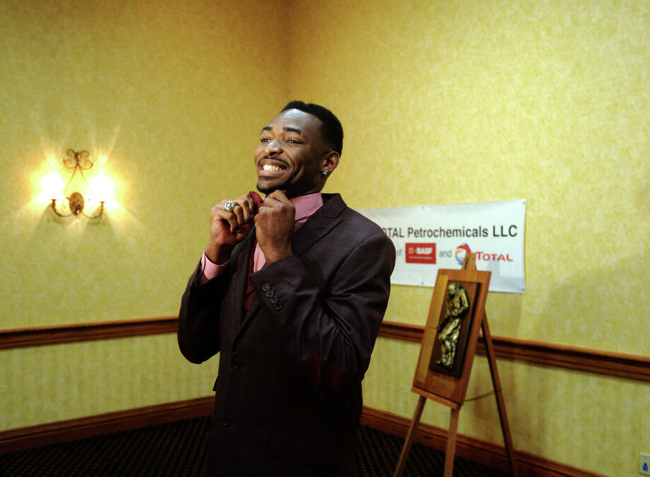 Central's Michael Jacquet III straightens his tie before an interview Wednesday night. Jacquet won the Willie Ray Smith offensive award. The Willie Ray Smith Awards were handed out at the MCM Elegante on Wednesday night.