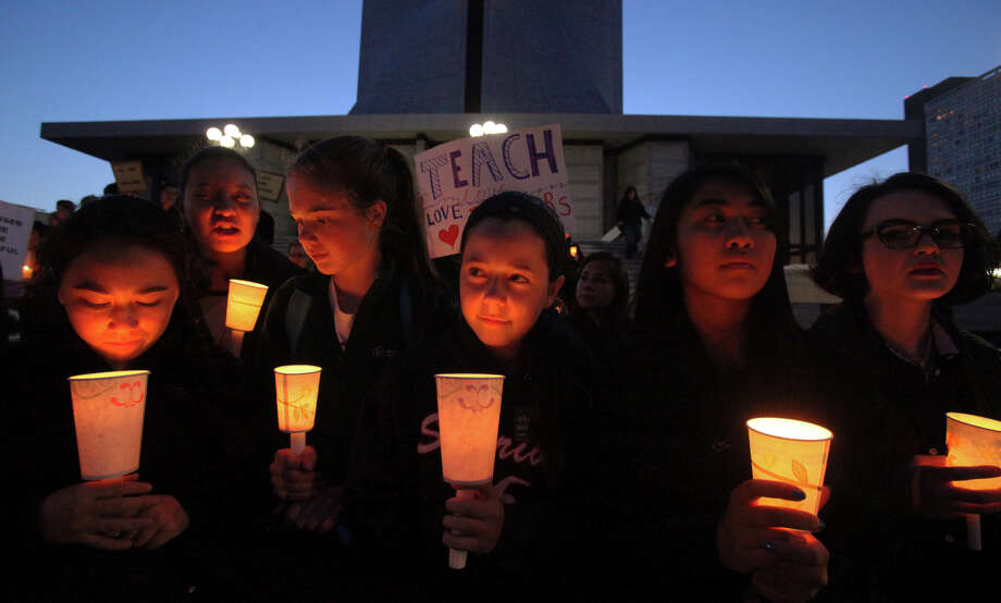 """Above: Alex Petrini, 14 (center), and classmates from Sacred Heart Prepatory School came to St. Mary's Cathedral for a candlelight vigil against the proposed """"morality"""" document. Photo: Santiago Mejia / The Chronicle / ONLINE_YES"""