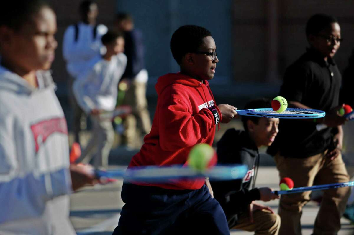 Nathan Smith, 12, left, Silas Miller, 13, Evan LeBlanc, 13, and Darnell Butler, 13, participate in the Club Mid afterschool enrichment program at the Weekley Family YMCA Wednesday.