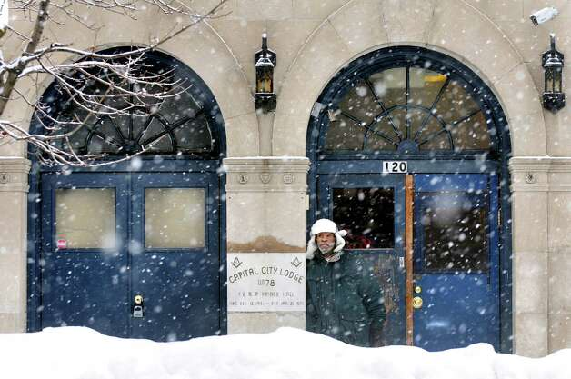 Hajj Sales of Albany takes refuge in a doorway on Madison Avenue during a snow squall on Wednesday, Feb. 19, 2014, in Albany, N.Y.  (Cindy Schultz / Times Union) Photo: Cindy Schultz / 00025822A